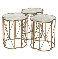 This trio of tables configures into an eclectic coffee table, a large and small side table, or three end tables. Antique gold leafing is hand applied to the metal bases, making each piece unique. Add gilded glamour to your romantic room with this mirrored masterpiece.