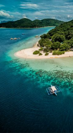 Drone photo of Banana Island in the Philippines. Amazing Drone Photos of the Philippines. We flew the drone, ate some lunch and then went snorkeling. It was the best snorkeling spot we stopped at that day and then moved onto the next island.  Click to see more drone photos of the Philippines by the Divergent Travelers Adventure Travel Blog at http://www.divergenttravelers.com/drone-photos-of-the-philippines/