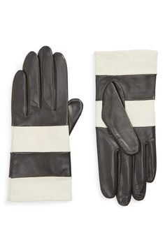 Classic Kate Spade gloves done in très chic stripes of ivory and black add Parisian-inspired style to any winter look.