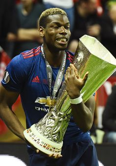 Manchester United's French midfielder Paul Pogba celebrates with the trophy after victory in the UEFA Europa League final football match Ajax Amsterdam v Manchester United on May 24, 2017 at the Friends Arena in Solna outside Stockholm. / AFP PHOTO / Jonathan NACKSTRAND