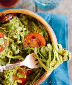 A Zucchini and Squash Pesto Salad with some fresh tomatoes and parmesan cheese. Perfect for a side dish, serve hot or cold, your choice!