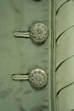 Buttons on a silk dress made by French designer Depret, ca. 1873 - 1875.