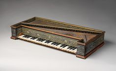 This octave virginal was made by Hans Rucker in Antwerp in 1581. It;s small size allowed it to sit in a larger virginal. Together they were known as a mother and child.