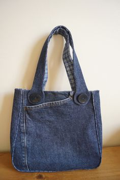 Really.  Not into recycled blue jean bags . . . but this one is kinda cute.  Good shape; interesting pocket; love the piping.