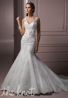 Gown features lace, beading, covered buttons over zipper closure, and floral belt.