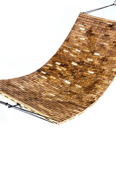 The Para Hammock. Over 700 Pieces of walnut connected by paracord. Flexing walnut tiles provide ultimate comfort and relaxation. Each piece is handcrafted one by one. The hammock is treated and finished to be outdoors.
