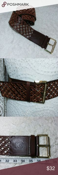 NWOT Vince Camuto Leather Belt Perfect new condition Vince Camuto Belt, lattice cut-outs shapes. Measures 37in long 3in wide. Beautiful belt to accent a dress, shirt, skirt or pant Vince Camuto Accessories Belts