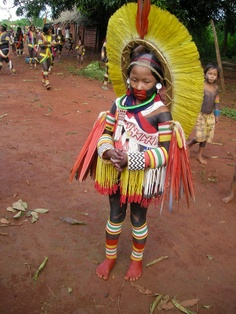 Young Kayapo Indian getting ready to celebrate Christmas.    The Kayapo are indigenous peoples in Brazil, from the plain lands of the Mato Grosso and Pará in Brazil, south of the Amazon Basin and along Rio Xingu and its tributaries. More info on the Kayapo: http://en.wikipedia.org/wiki/Kayapo_people    In the distinctive dress of the Kayapo Indians in Brazil, a child readies to celebrate with dance and music!