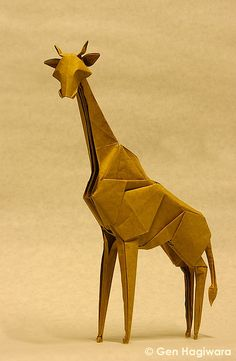 Go on an origami safari with these amazing African animals folded from paper. You'll see origami lions, giraffes, elephants, cheetahs and much more! Origami Ball, Origami Lion, Instruções Origami, Origami Simple, Origami Paper Folding, Origami And Kirigami, Paper Crafts Origami, Paper Oragami, Origami Ideas