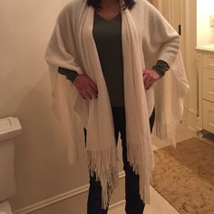 Ivory poncho Never worn. Don't be afraid to ask or question or to make an offer :) East 5th Sweaters