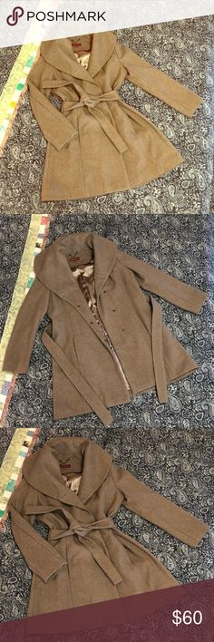 Beautiful & dressy tan wool, fully lined coat!!!!! This gorgeous coat is fully lined with camel/tan colored silk with red piping, the outside is wool and in perfect condition. I only wore it once as it is a little big on me. Large stylish lapel and attached belt on front, also has snaps and a button inside. Absolutely beautiful coat. Merona Jackets & Coats Pea Coats