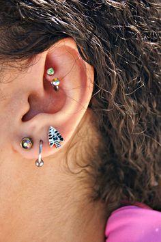 Sister's piercings. rook, three ear piercings.
