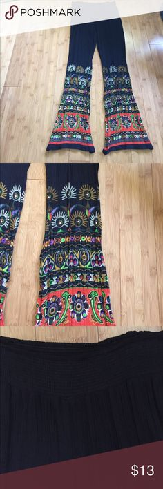 BOHEMIAN TIGHT BELL BOTTOMS Great fitting pants and so comfortable, black background with vibrant colors on the bottom, elastic waist and worn once Patrons of Peace Pants Boot Cut & Flare