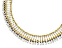 AN ARCHEOLOGICAL REVIVAL PEARL AND ENAMEL NECKLACE   Designed as a fringe of tapering drops with circular blue enamel detail and pearl terminals suspended from a reel-link neckchain, pearls untested, circa 1870, 41.0 cm long