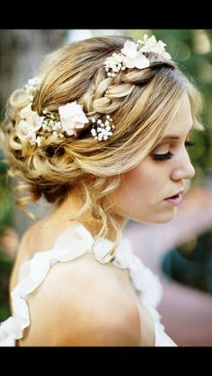 Rose buds and baby's breath braided into hair for church wedding