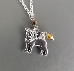 Cute pug pendant necklace with yellow crystals in silver tone metal fashion jewellery