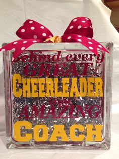 This custom glass block is a great unique gift for any amazing cheerleading coach. Customized in the team colors and the year and cheerleaders