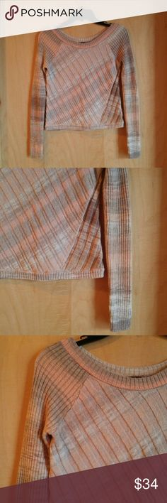 Free People Marbled Colors Cropped Sweater Free People sweater, size extra small, in excellent condition! Unique marbled look to the warm orange and brown colors. Diagonal stripes oppose diagonal knit. Slightly cropped. Please ask any questions. No trades. Make a reasonable offer. Thanks! Free People Sweaters Crew & Scoop Necks