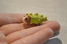 Clay guinea pig in a dino costume. Cute little guy