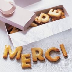 """send your guests home with a lovely box of cookies that says """"thank you"""" in the language of love!"""