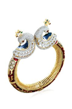 A two peacock wrist wear by Entice (celebrity Indian Jewelry designers) set with diamonds and enamel.  The peacock is the national bird of India.