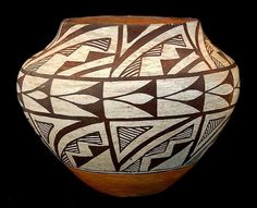 Vintage Pottery 46. A circa 19th century pottery vase/bowl with traditional black and white geometric designs with red band along the bottom. No signature present. In great condition for its age, slig