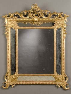 "An exuberant Louis XV style gold leaf ""pareclose"" frame with the original mirror glass from France c.1880. The unusual arrangement of the separate pieces of mirror glass seen here give this type of mirror its distinctive name of a ""pareclose""."