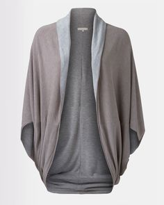 Soft, knit reversible draped cardigan without closure. Versatile, comfortable and extremely functional for the woman on the go. Wearable in a variety of different ways.
