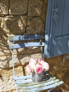 """the picture is called """"Roses""""…but i think it's about the feeling of sun-warmed bricks beside a blue shutter."""