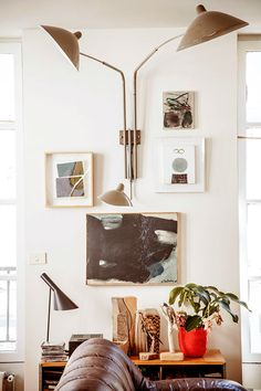 A mini gallery wall with unique art and a light fixture in serge bensimon's home / sfgirlbybay