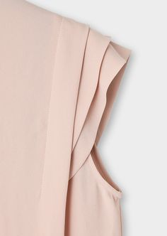 Pleated sleeve.