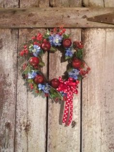 Red, white & blue patriotic wreath with red apples and raspberries