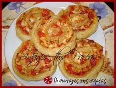 ρολάκια σοφολιάτας με τυρί φέτα και ντομάτα.