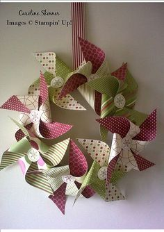 We did this 2013!  Had fun picking paper and buttons and seeing how they worked together. pinwheel wreath - nice color/pattern combo!