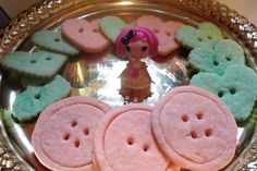 Lalaloopsy birthday party button sugar cookies!  (just a small sample of the cookies I made)  What I used: one bag of sugar cookie mix, a little food coloring, some cookie cutters, and a straw to poke out the holes for the buttons.