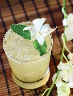Hawaiian Queen Bee 4 (1-inch) cubes fresh pineapple 1 1/2 oz. light rum 1/2 oz. overproof rum 1 oz. honey syrup (1:1) 3/4 oz. fresh lemon juice Garnish: sugar rim, mint and edible orchid (optional)
