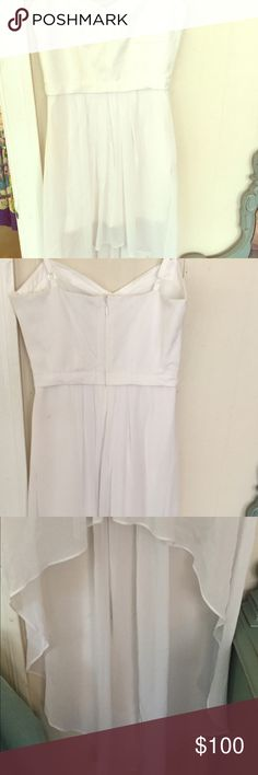 WHITE HIGH LOW BCBGMAXAZRIA DRESS Only worn once. Unfortunately I don't fit into it. In great condition and is dry clean only. A great summer dress! BCBGMaxAzria Dresses High Low