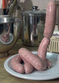 Links of homemade sausage extruded from a stand mixer with grinding and stuffing attachments.