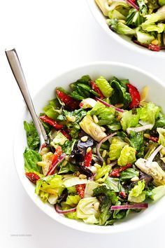 Our Family's Favorite Salad is made with lots of artichoke hearts, roasted red peppers, toasted pine nuts, and a zesty Parmesan vinaigrette. SO delicious, and always a crowd pleaser! | gimmesomeoven.com