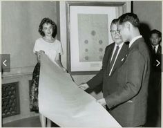 Photograph of King of Thailand Viewing Facsimiles of Early Siamese Treaty with Pat Steffing and Third Archivist of the United States Dr. Grover, 1960, via Flickr. Photograph of King of Thailand Viewing Facsimiles of Early Siamese Treaty with Pat Steffing and Third Archivist of the United States Dr. Grover, 1960