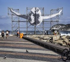 "The Olympic Games are coming closer and closer and in order to celebrate such a big event, artist JR decided to create two new public artworks in the city, where whole sport event is going to take place this year. The installations are built upon the French artist's already going ""Inside Out' proj…"