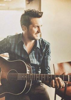 Luke Bryan  Kiss Tomorrow Goodbye https://www.youtube.com/watch?v=a5M_rT89kxY This photo looks kind of faded like an old photo and rustic. I also like this photo because it is using principles like side light, drawing attention to certain features on his face. It also uses the principle of window light which brightens it up and also attracts you to his face and body structure. Also some slight blur in the background, makes it overall kind of cool looking, and draws the attention more towards…