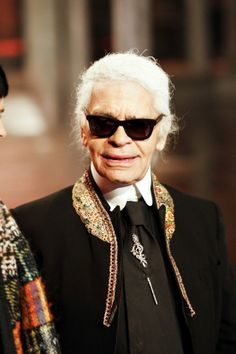 Chanel 2014. Carl's looking a bit old in this shot. I wonder how old he is?