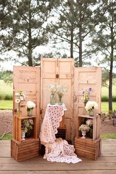 Rustic Wedding Decoration Backdrop-- like the use of crates for displaying flowers