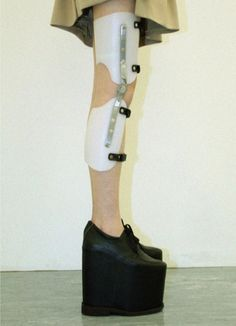 egle cekanaviciute leg brace  moldable plastic / stainless steel / leather---This is a model of the first plastic brace. A build up was put on a shoe most of the time, because polio would sometimes stunt the growth of just one leg.