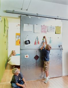 David Baird designed the custom sliding doors with materials and hardware from Home Depot. The doors also act as a makeshift critique wall for Bo and Sky's artwork. Tagged: Doors, Sliding Door Type, Interior, and Metal. Photo 6 of 13 in Baton Rouge Oasis. Sliding Wall, Sliding Doors, Metal Doors, Metal Barn, Door Design, House Design, Fence Doors, Basement Bedrooms, Basement Remodeling