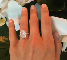 Julianne Hough's engagement ring, an oval solitare diamond set on a thin pavé band