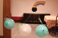 Balloon races. Balloons stuck to straws threaded through string, blow them up and let them fly!