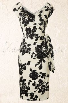 The Pretty Dress Company - Hourglass Cream and Black Rose Vintage Pencil dress. Elegance at it's best! Beautiful 50s inspired pencil dress with a beautiful black Rose print on cream.Made of a flattering firm sateen cotton (luxe cotton with a mat sheen on it) with a soft stretch for the perfect fit! The wide sweatheart neckline with faux wrap detail is suited for almost all cup sizes and gives the illusion of a smaller waist which creates the perfect silhouette. The bodice is lined to hold...