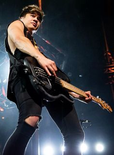 this boy makes me wanna learn how to play bass. and I ought to, I already know guitar :)